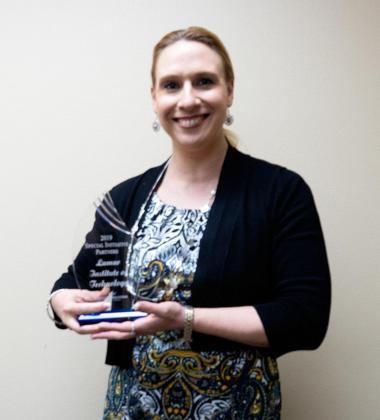LIT's Dean of Strategic and Workforce Initiatives Dr. Miranda Phillips holds the 2019 Special Initiative Partners Award from Workforce Solutions of Southeast Texas. Phillips wrote the grant to launch the inaugural Women's Entrepreneurship Boot Camp.