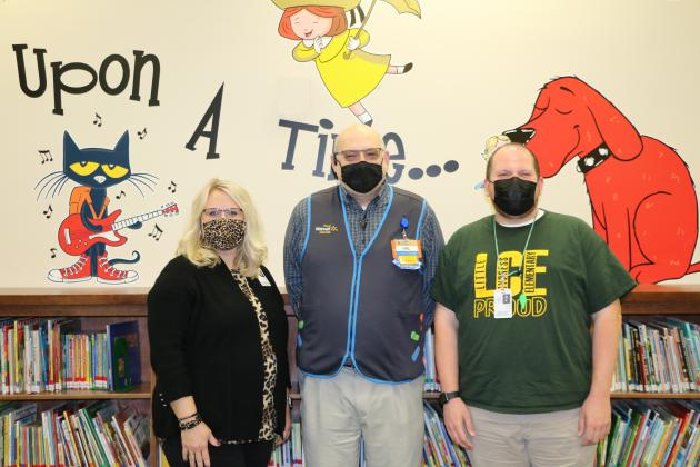 From left: LCE Principal Kayla Casey, West Orange Walmart Manager Hal Biskey and LCE Music Teacher Josh Leger